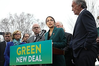 Photo of Alexandria Ocasio-Cortez unveiling her Green New Deal proposal in an article by #dk on African-American Conservatives AACONS.